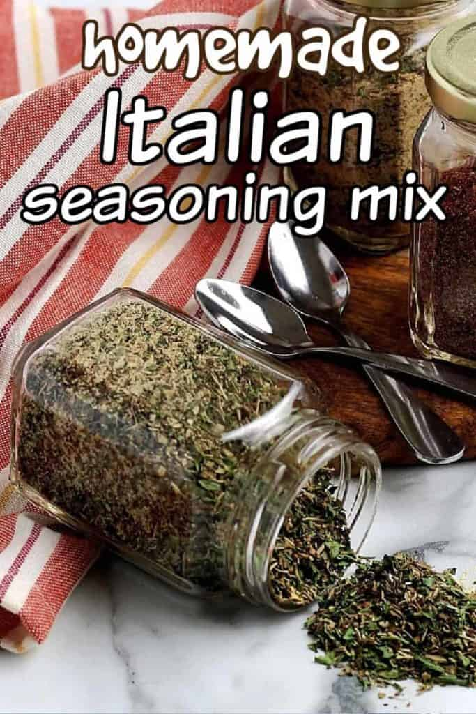 A jar of spilled Italian seasoning in front of two jars of different mixes.