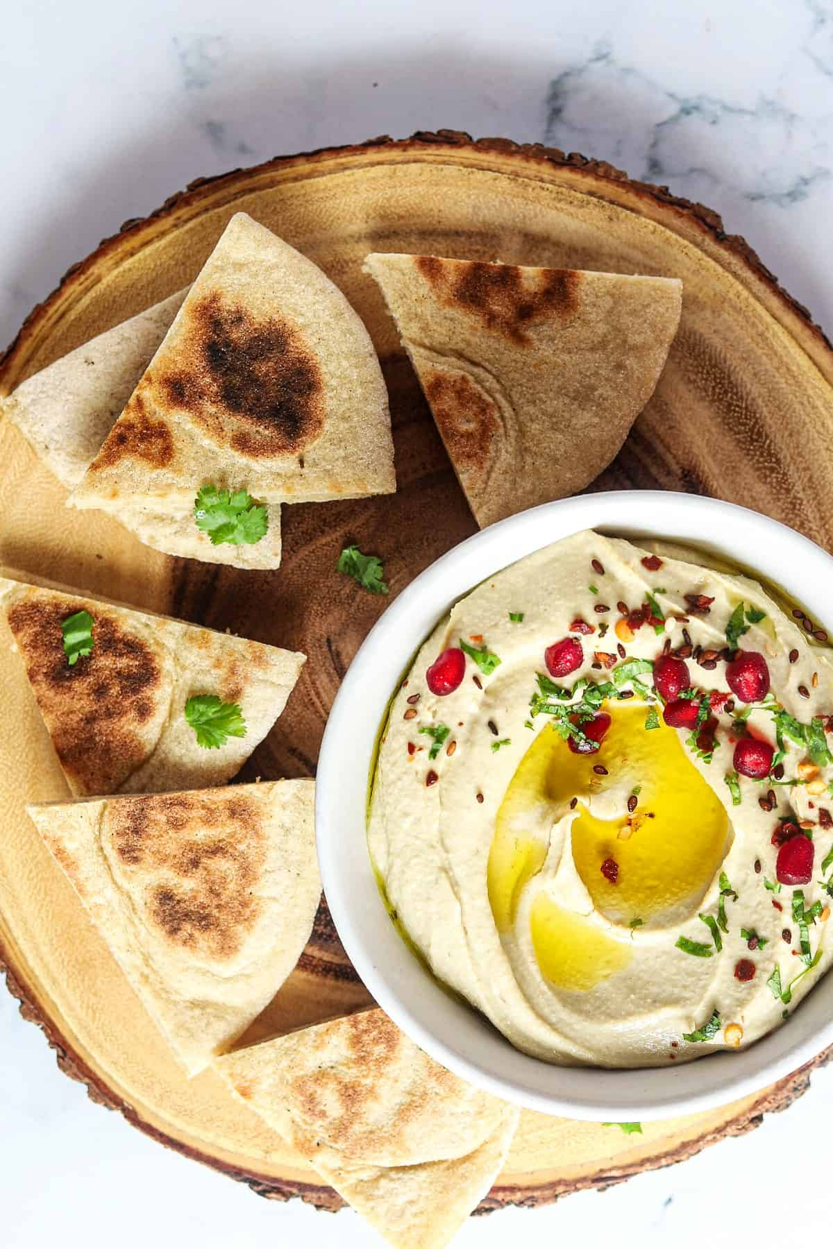 Bread triangles served up alongside a bowl of hummus.