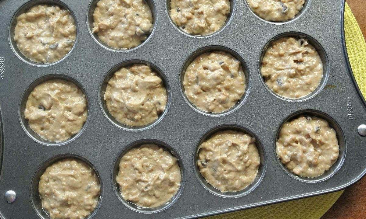 Overhead photo of a muffin tin filled with batter.