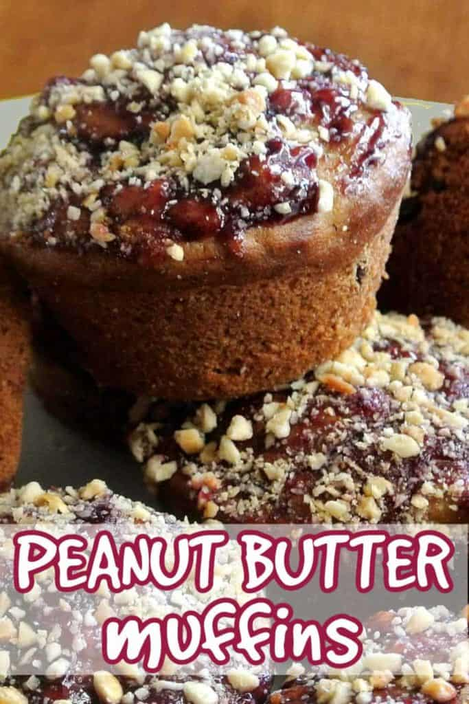 Close up pile of Iced peanut butter muffins with peanuts on top.