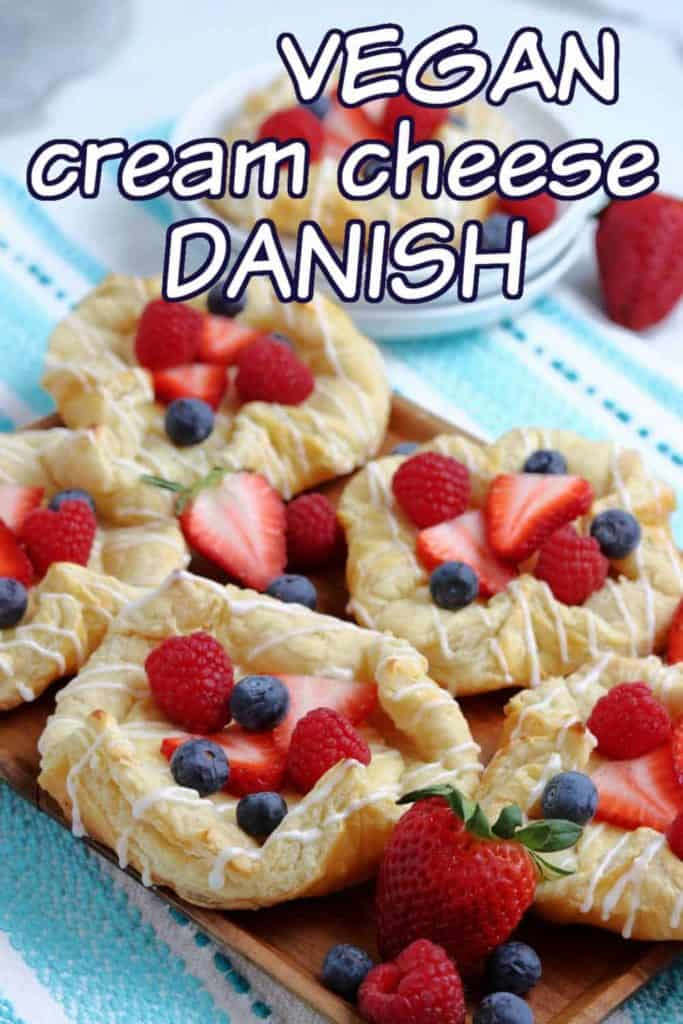 Vegan cream cheese danish om a wooden serving tray.