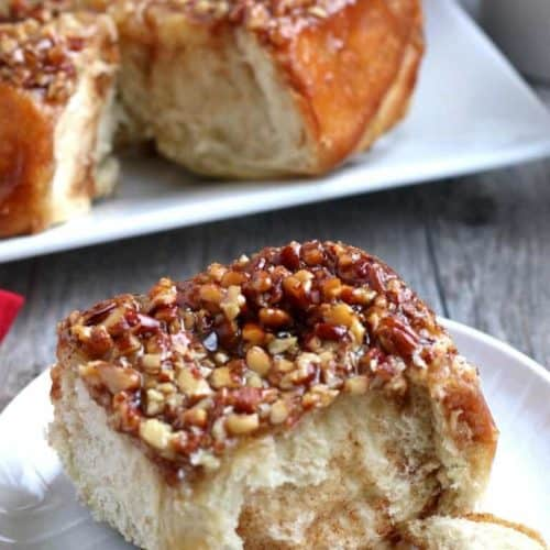 One up close sticky bun with the full loaf behind.