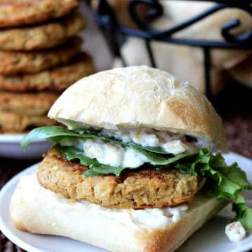 Bun filled with a baked falafel patty with lettuce and mayo.