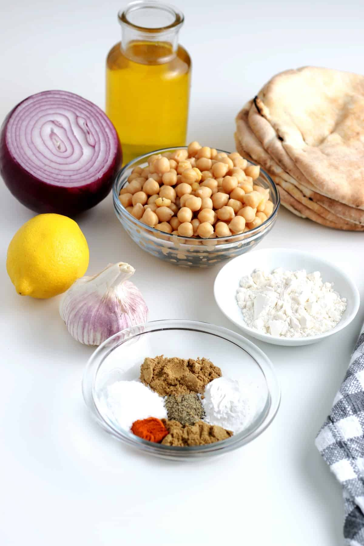 All of the ingredients in small bowls for falafel sandwiches.