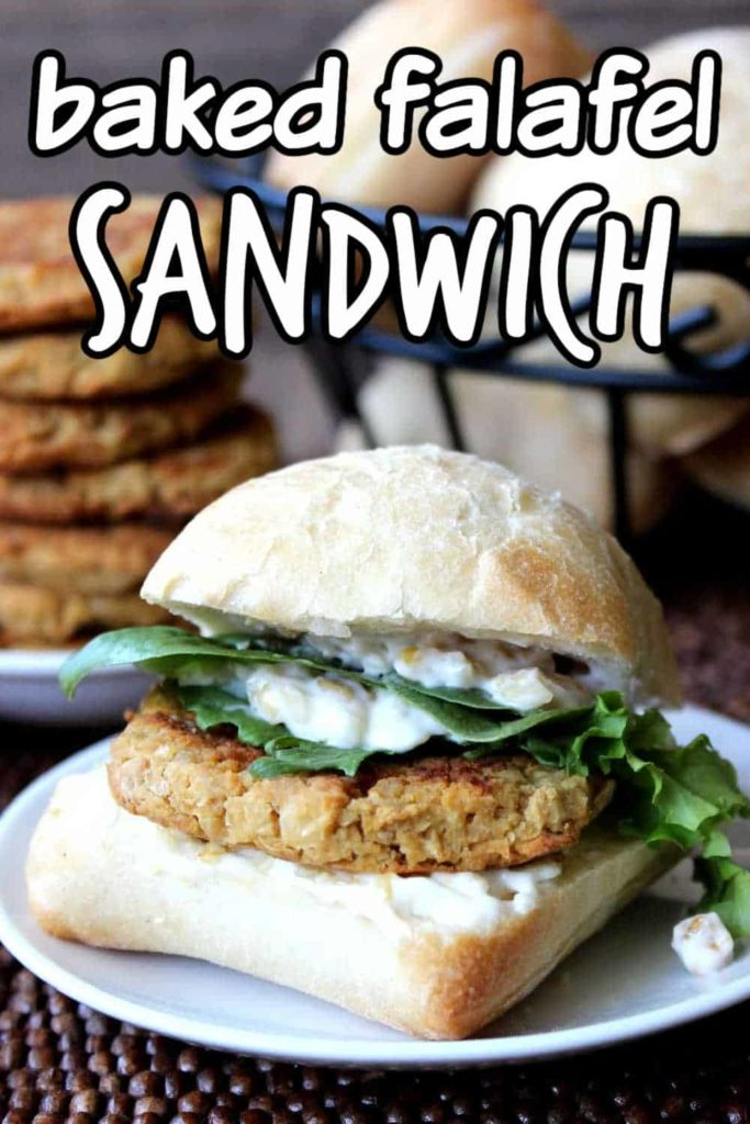 Fat falafel patty in between a buns, spread and lettuce.