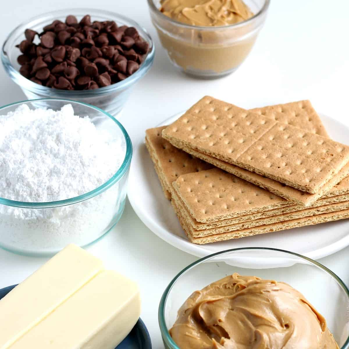 Five ingredients i separate bowls for chocolate peanut butter bars.