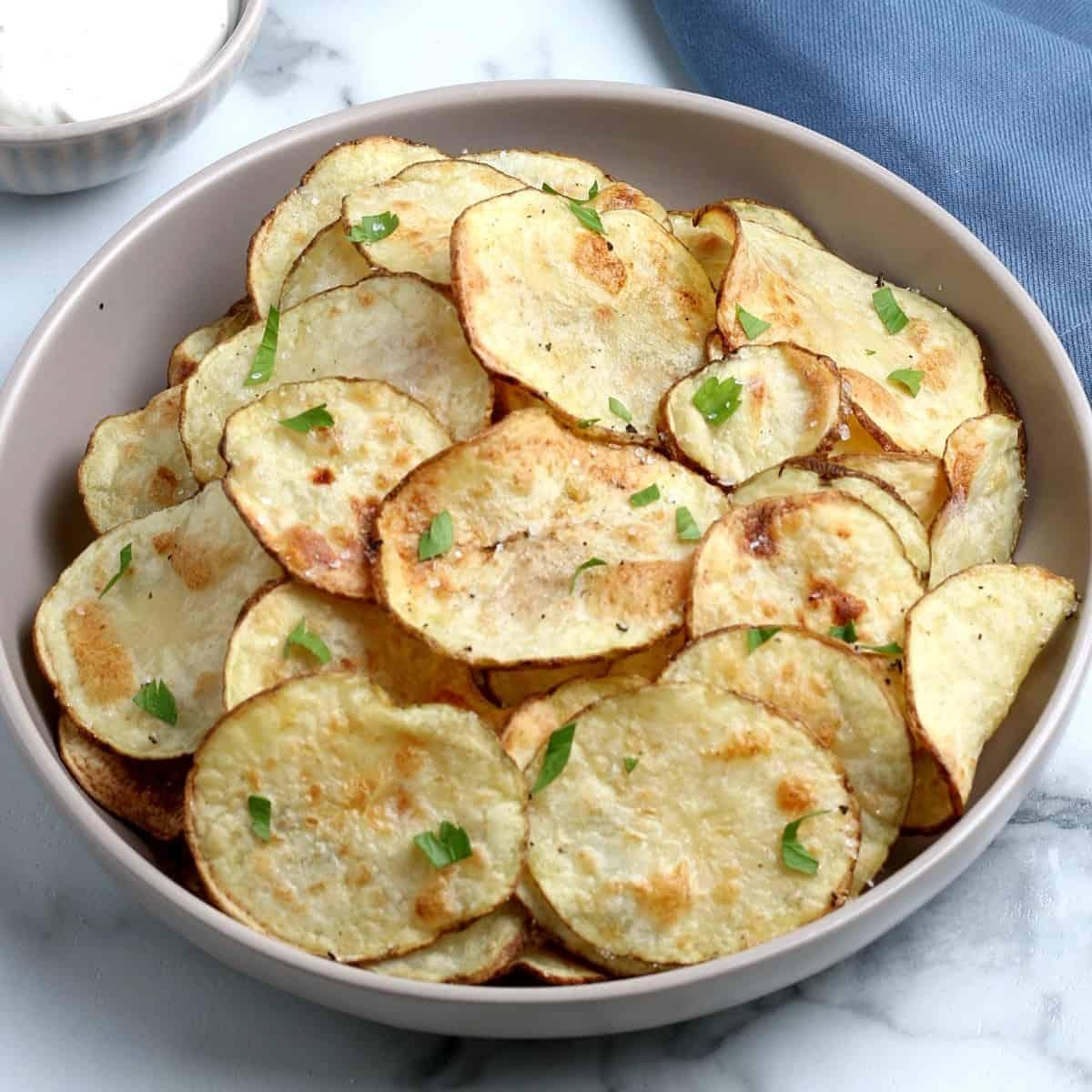 Tilted bowl filled with fried vegetable snacks.