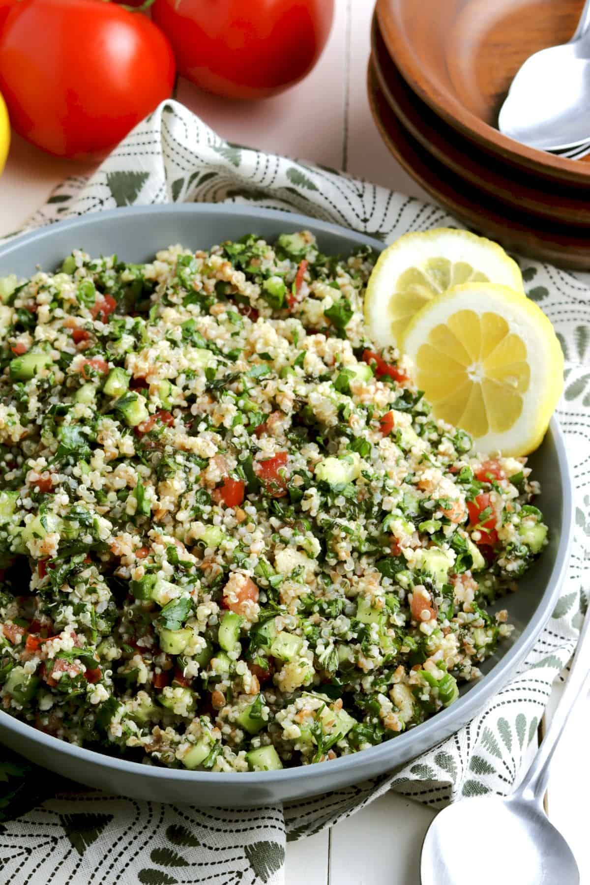 Huge tilted bowl filled with fresh tabouli salad
