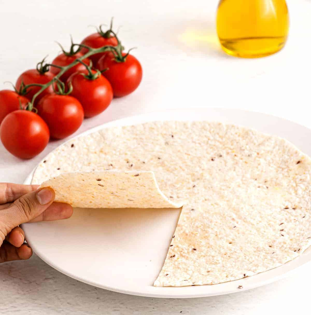 Showing the tortilla cut in preparation for folding your lunch.