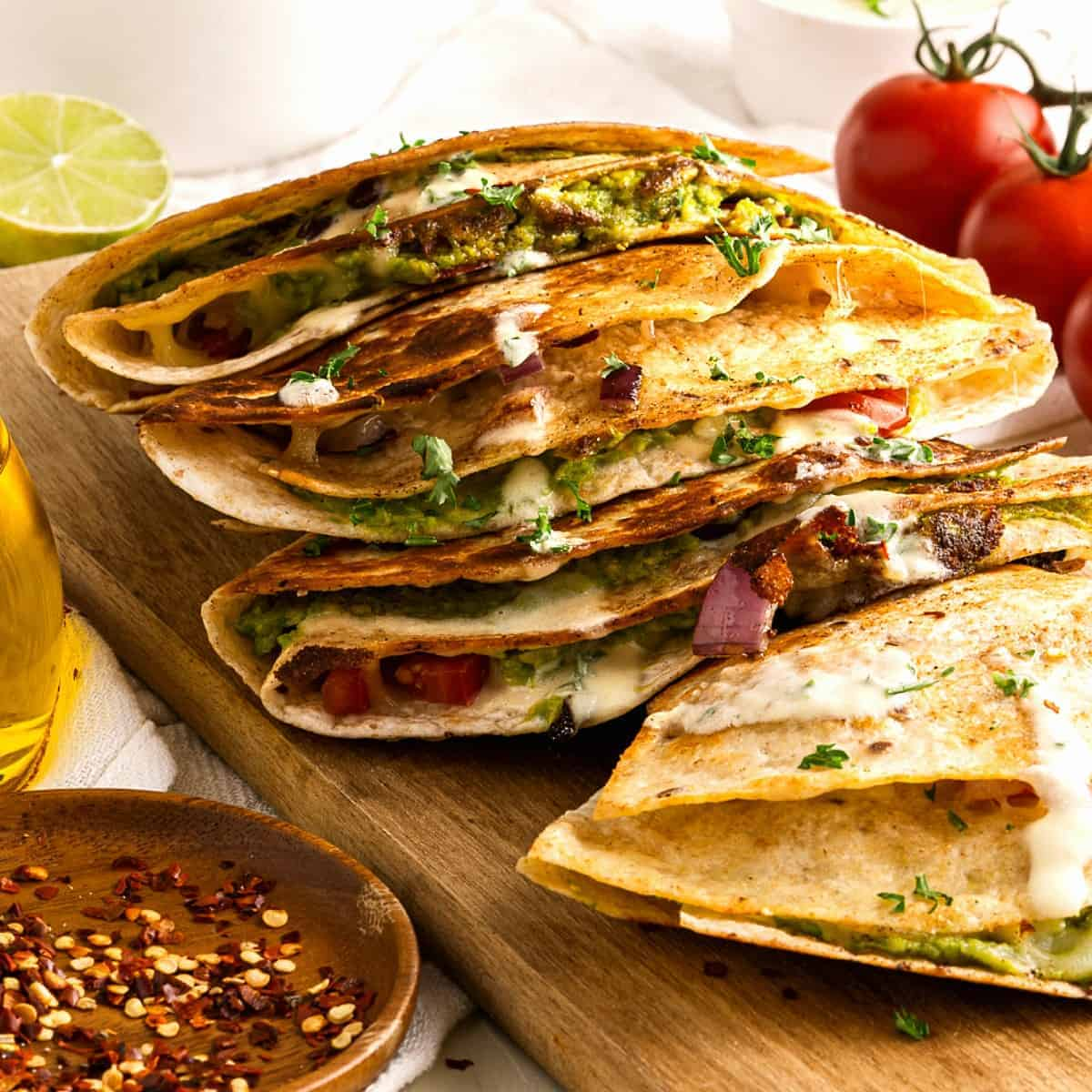 Front view of cooked and quesadillas that are stacked on top of each other.