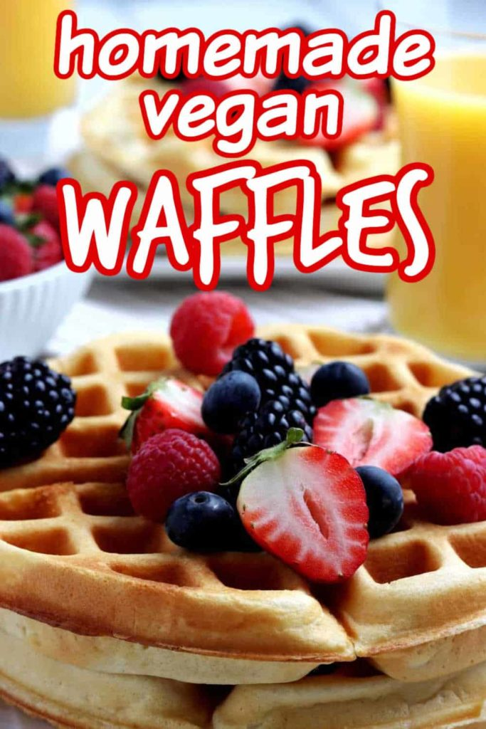 Closeup of a stack of vegan waffles with berries and text.