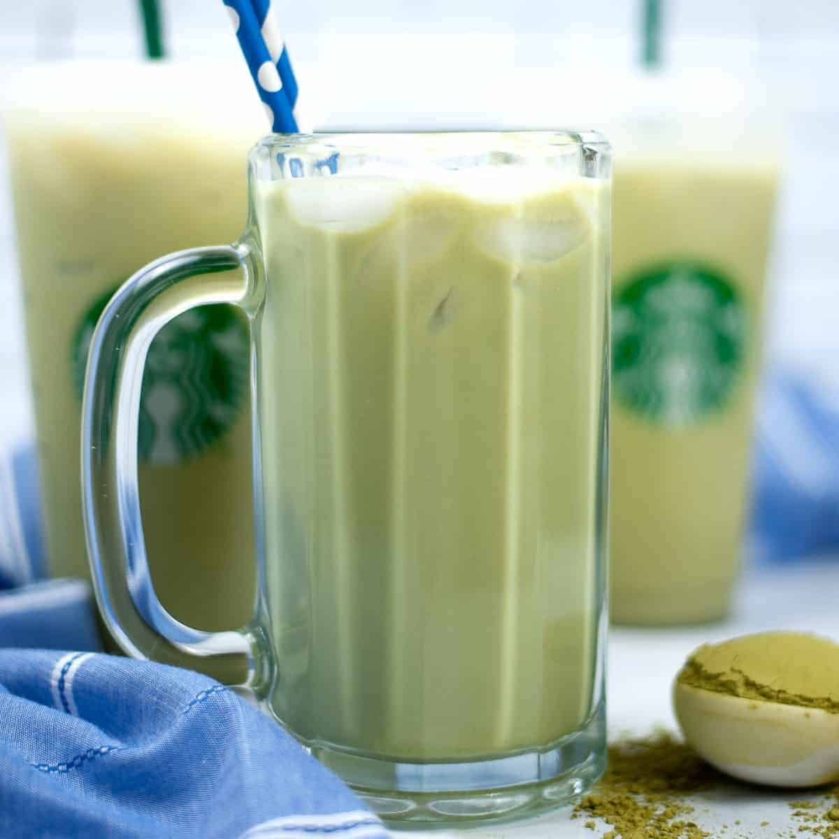 Tall glass mug filled with iced green tea latte,