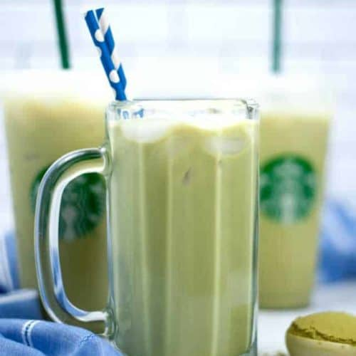 Three drinks of iced match green tea latte with straws.