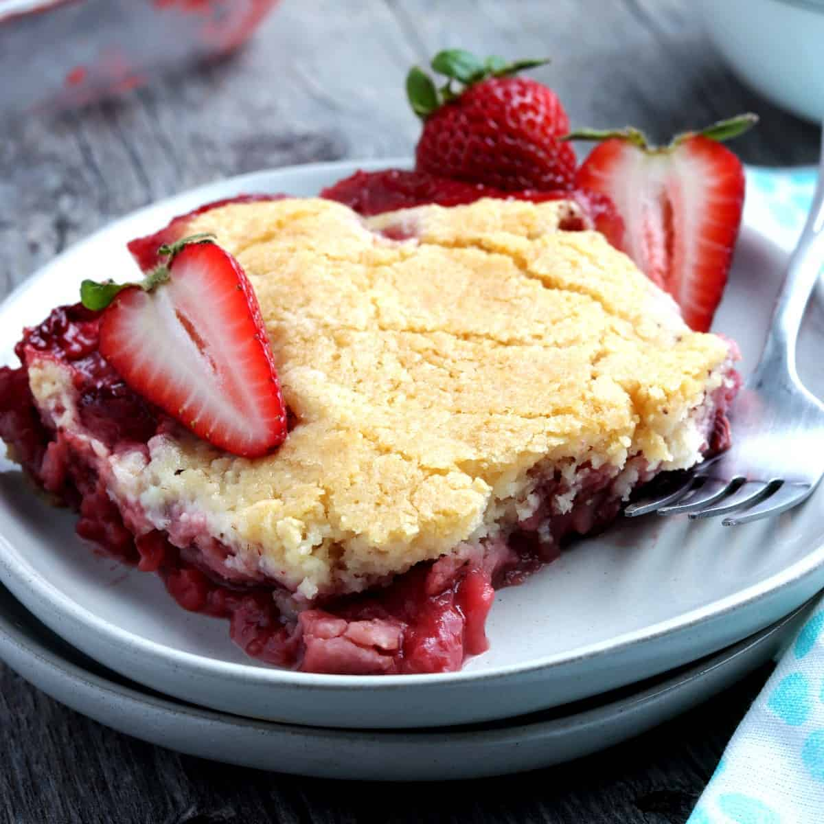 One generous square piece of strawberry cobbler on a serving plate.