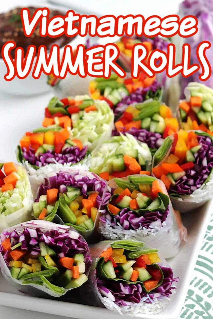 Close view of veggie filled summer rolls on a plate with peanut dipping sauce.