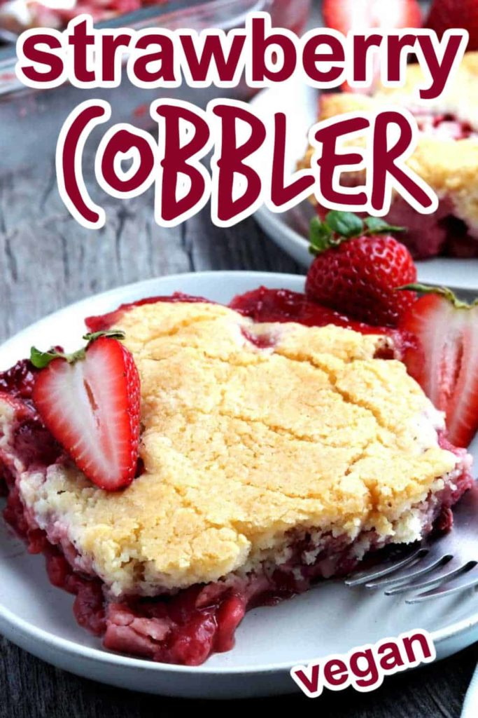A Big square of strawberry cobbler dessert with a fork on the side.